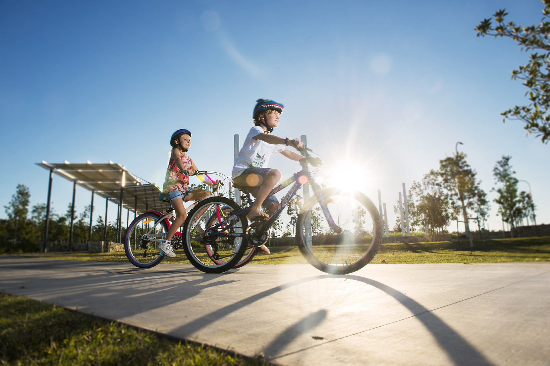 Kids riding their bikes around Yarrabilba, Queensland Australia