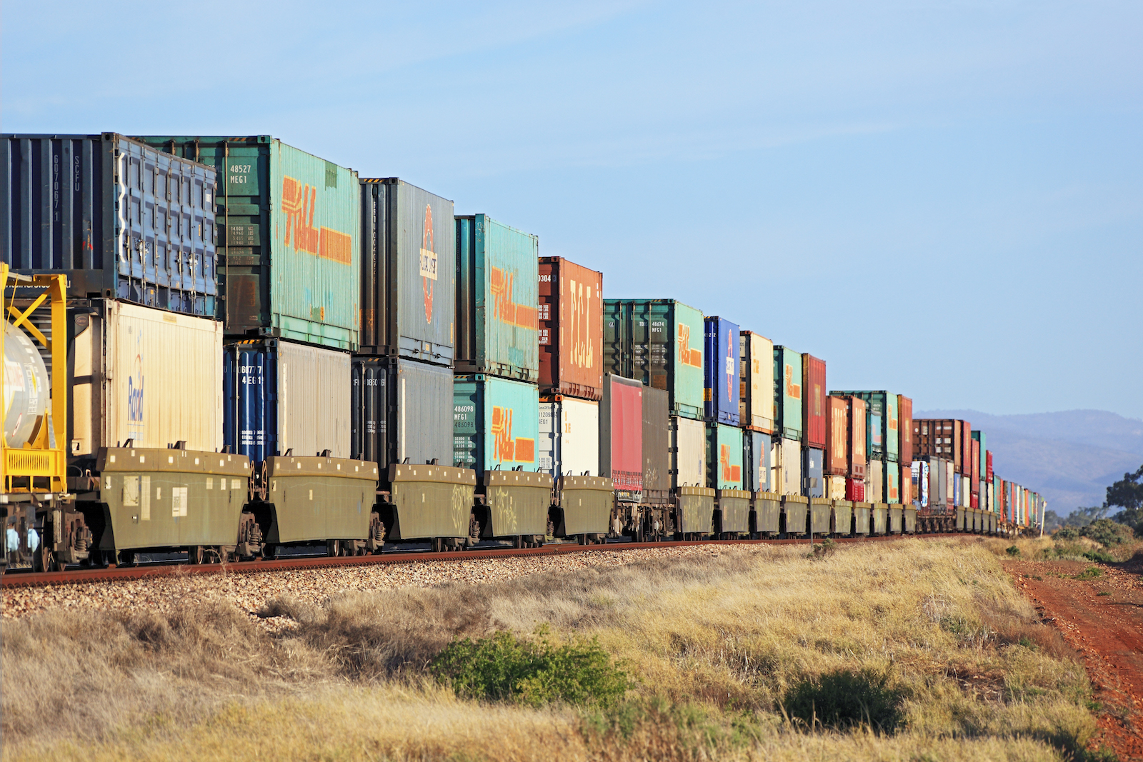 Inland Rail train carrying multiple shipping containers, Australia