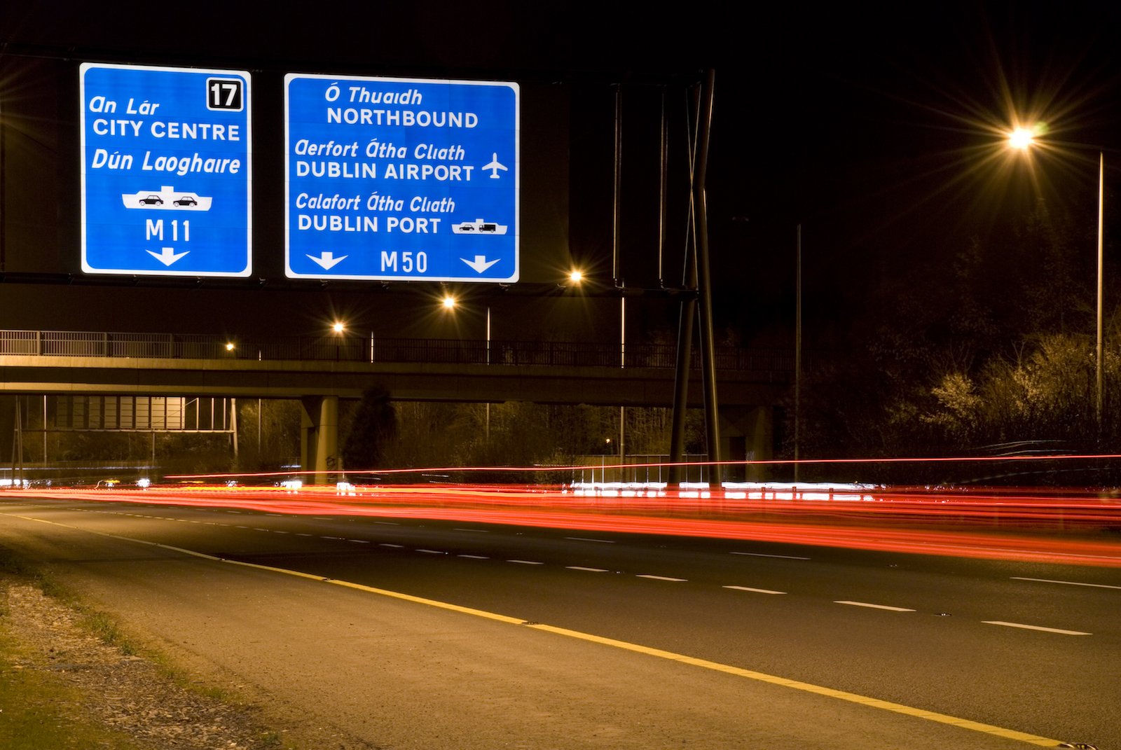 Way finding signage over motorway in the evening in Ireland