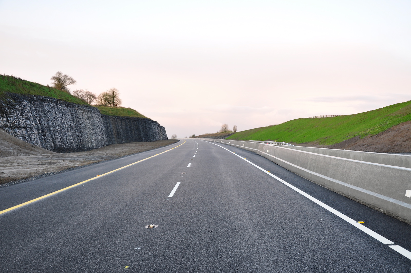 M6 motorway Ireland with rock cut out wall.