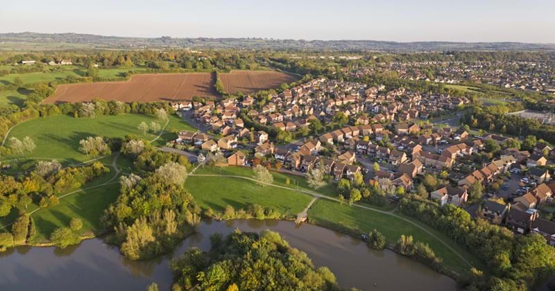 Land - Homes - Residential - English Suburban Town - River And Fields - shutterstock_126251357.jpg