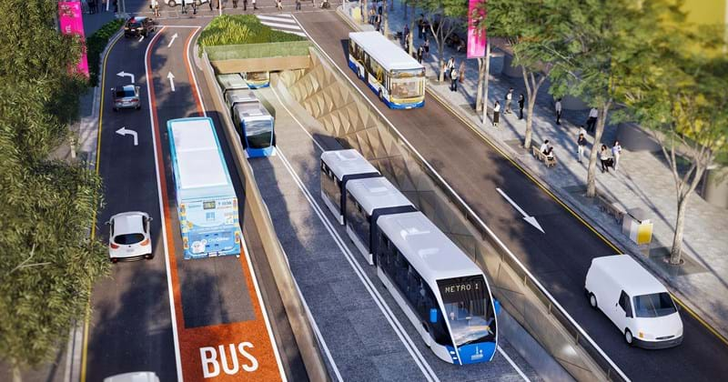 Mock up of what Brisbane Metro will look like once complete showing metro tram in conjunction with inner city buses, vehicles and pedestrians.