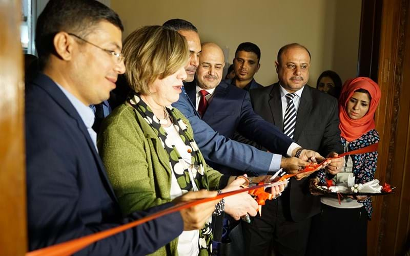 Cutting the  ribbon at the opening ceremony at the Basrah Museum