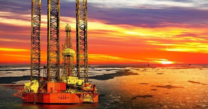 Offshore rig at sunset on frozen waters