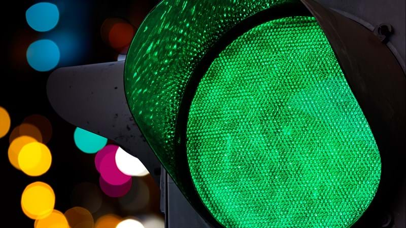 Green traffic light representing fast tracked infrastructure
