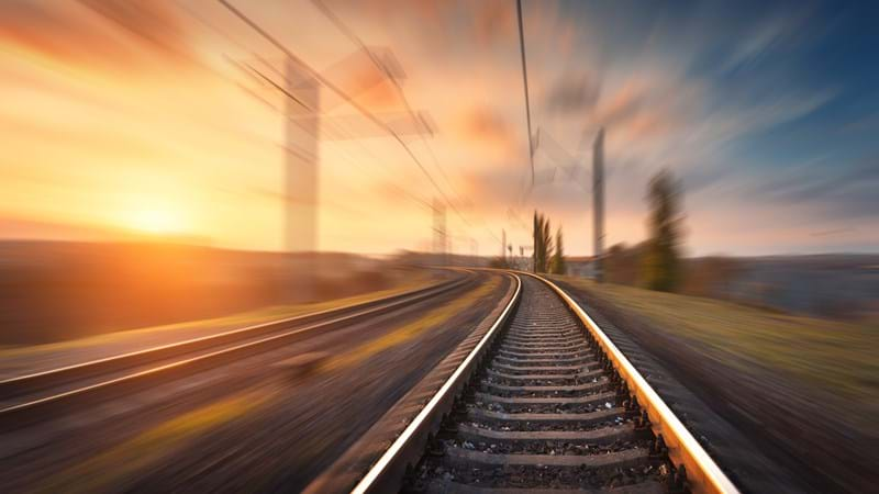 Fast tracked infrastructure shown through blurred rail line